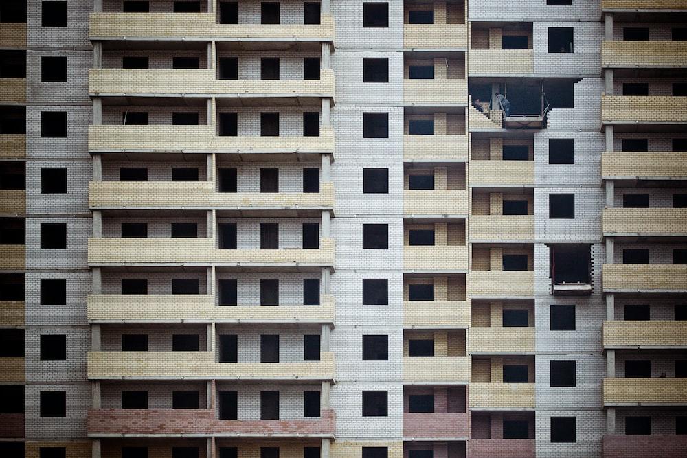 white and brown concrete apartment