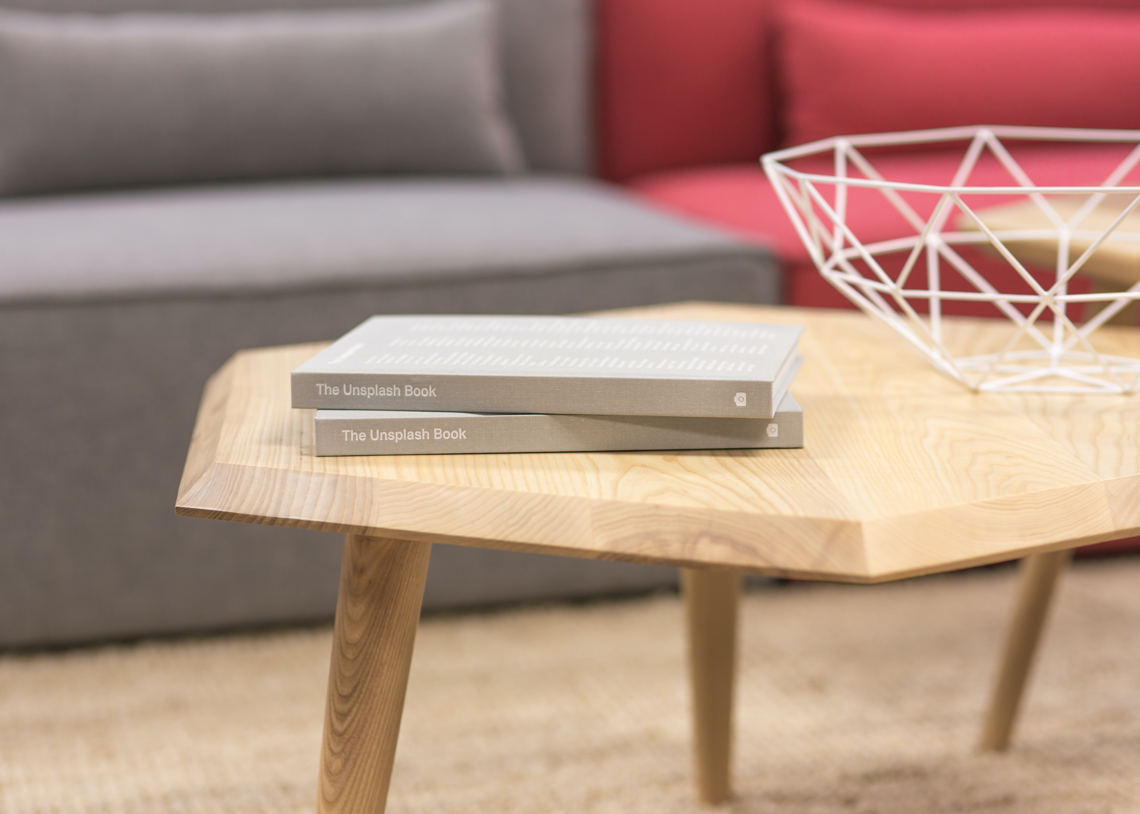two gray books on brown wooden table