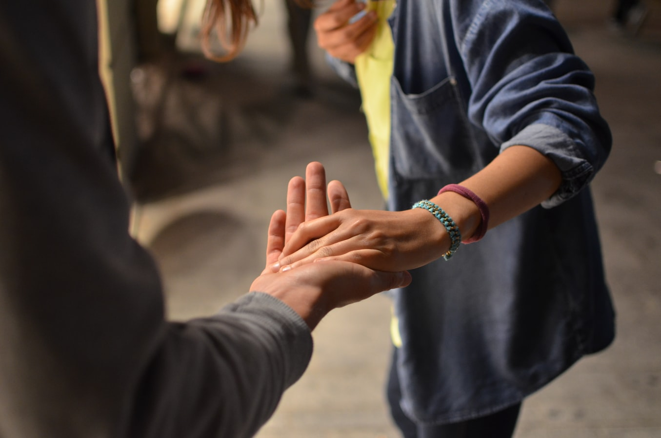 Two people extending thier hands