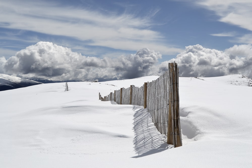 snow fence in deep snow drift