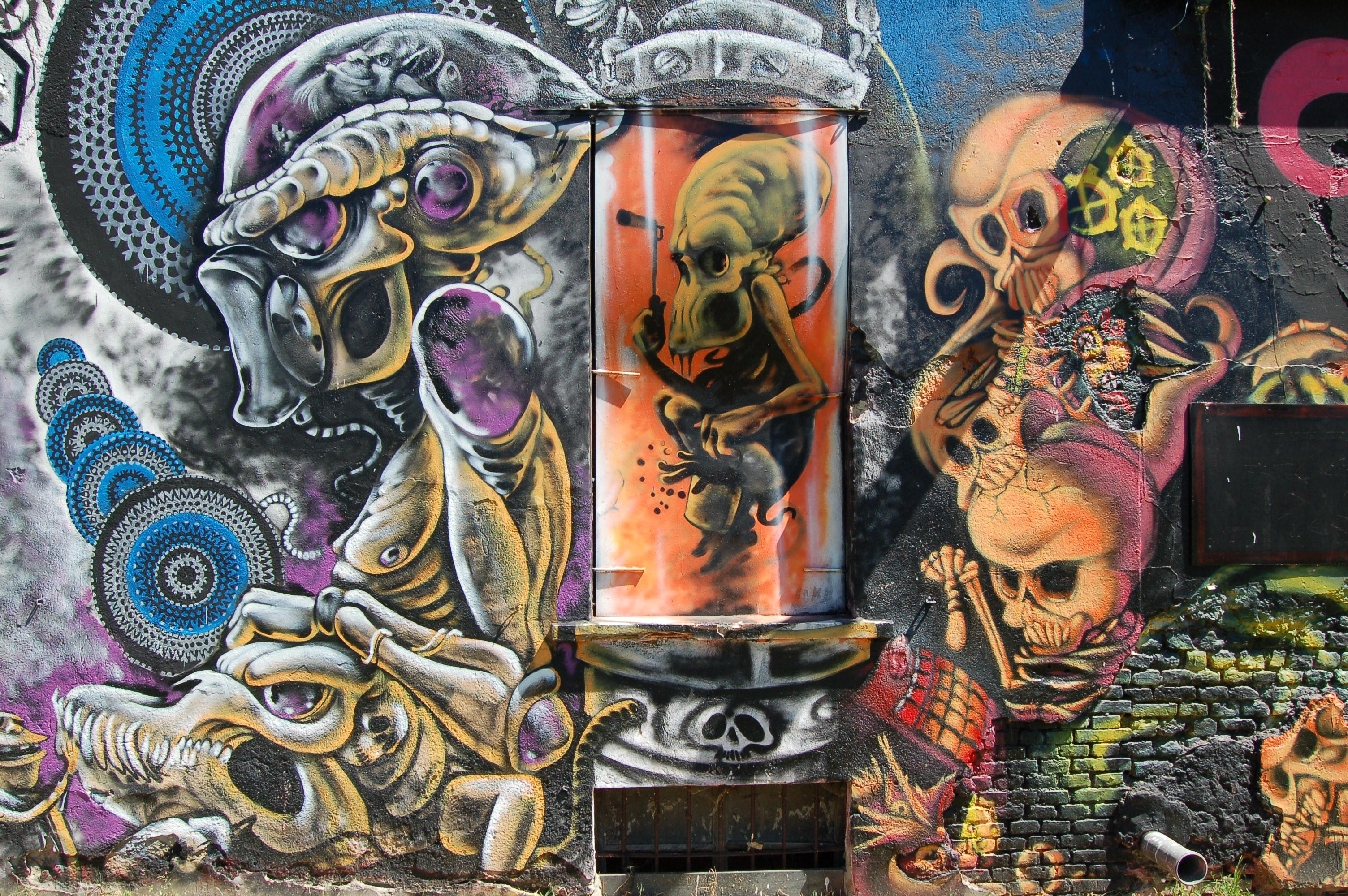 A wall mural with skeletons and other weird creatures.