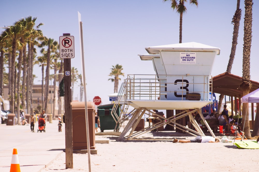 lifeguard houses under bright skty