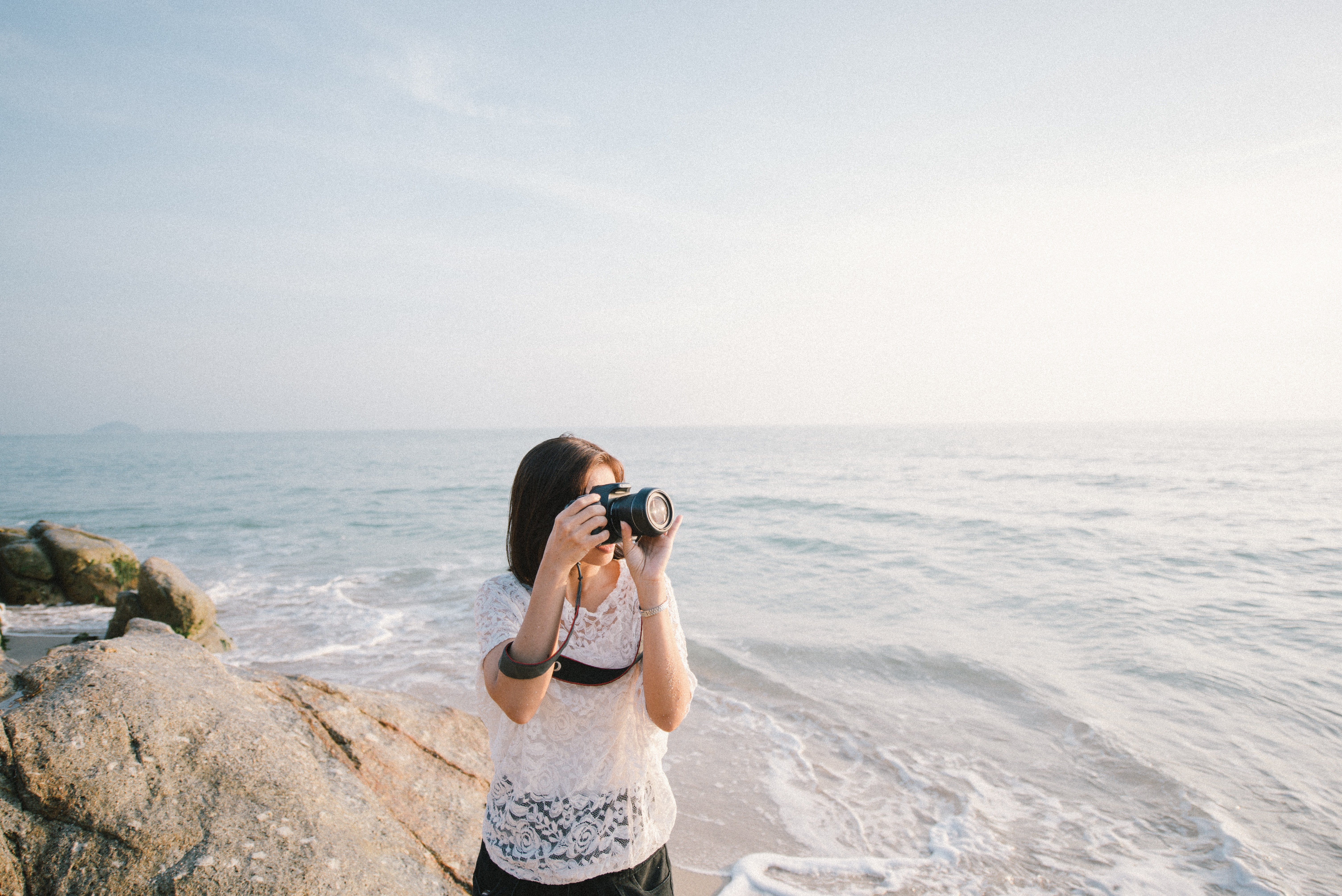 woman taking a photo using a DSLR camera