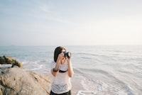 woman taking a photo using a DSLR camera