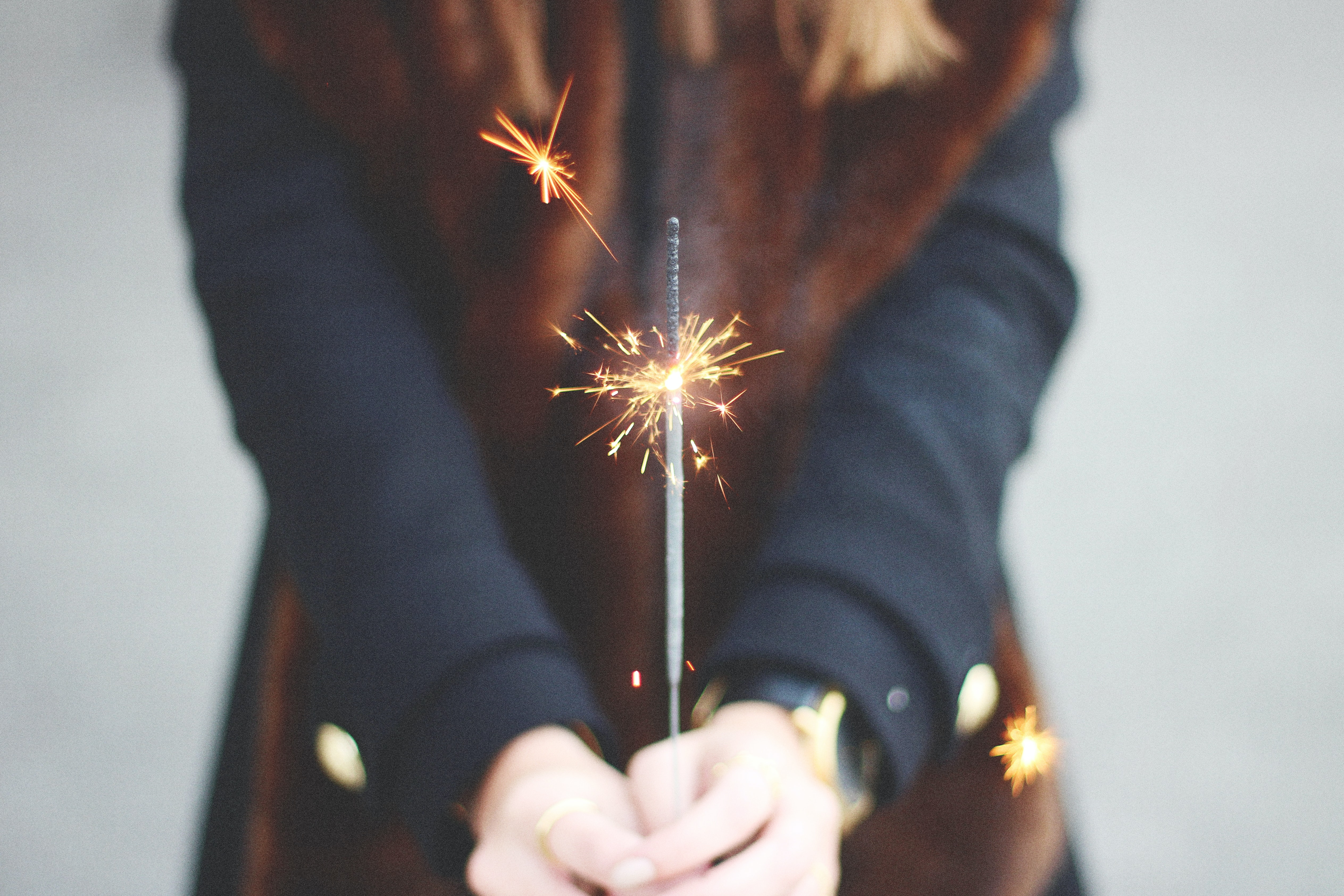 woman holding spark