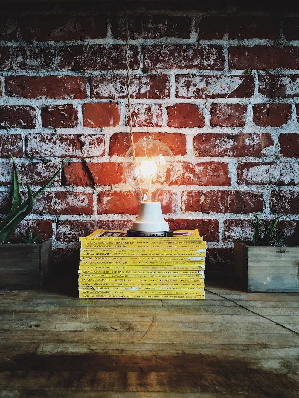 light bulb on pile of books