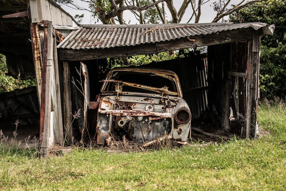 vintage car on garage during daytime