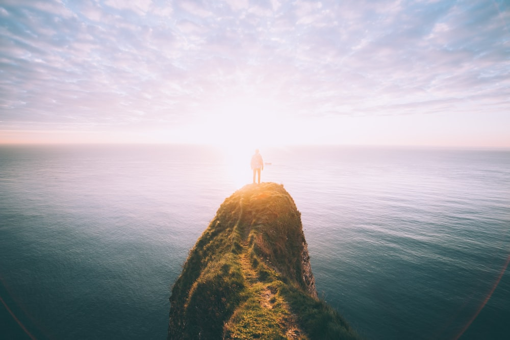 person on top of the cliff