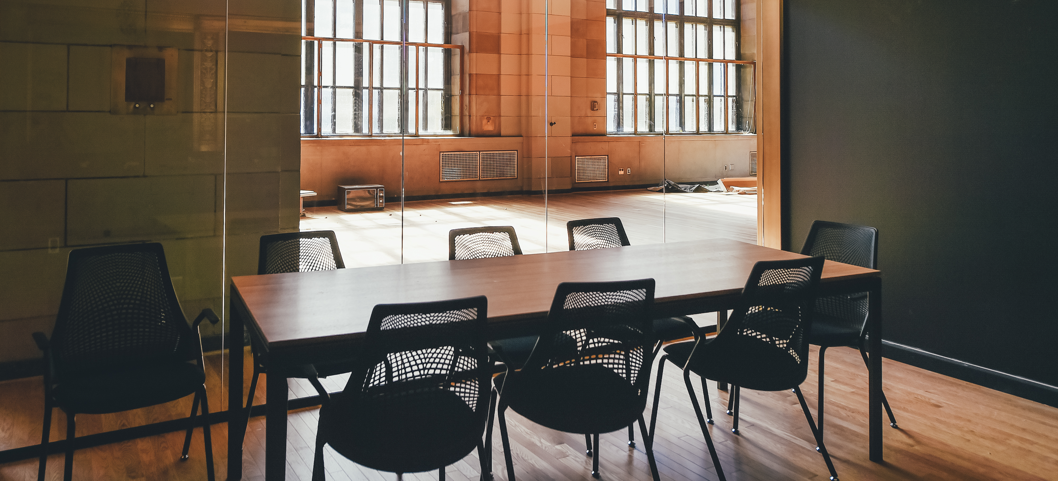 office space image. An Empty Table With Several Chairs In A Small Conference Room Office Space Image