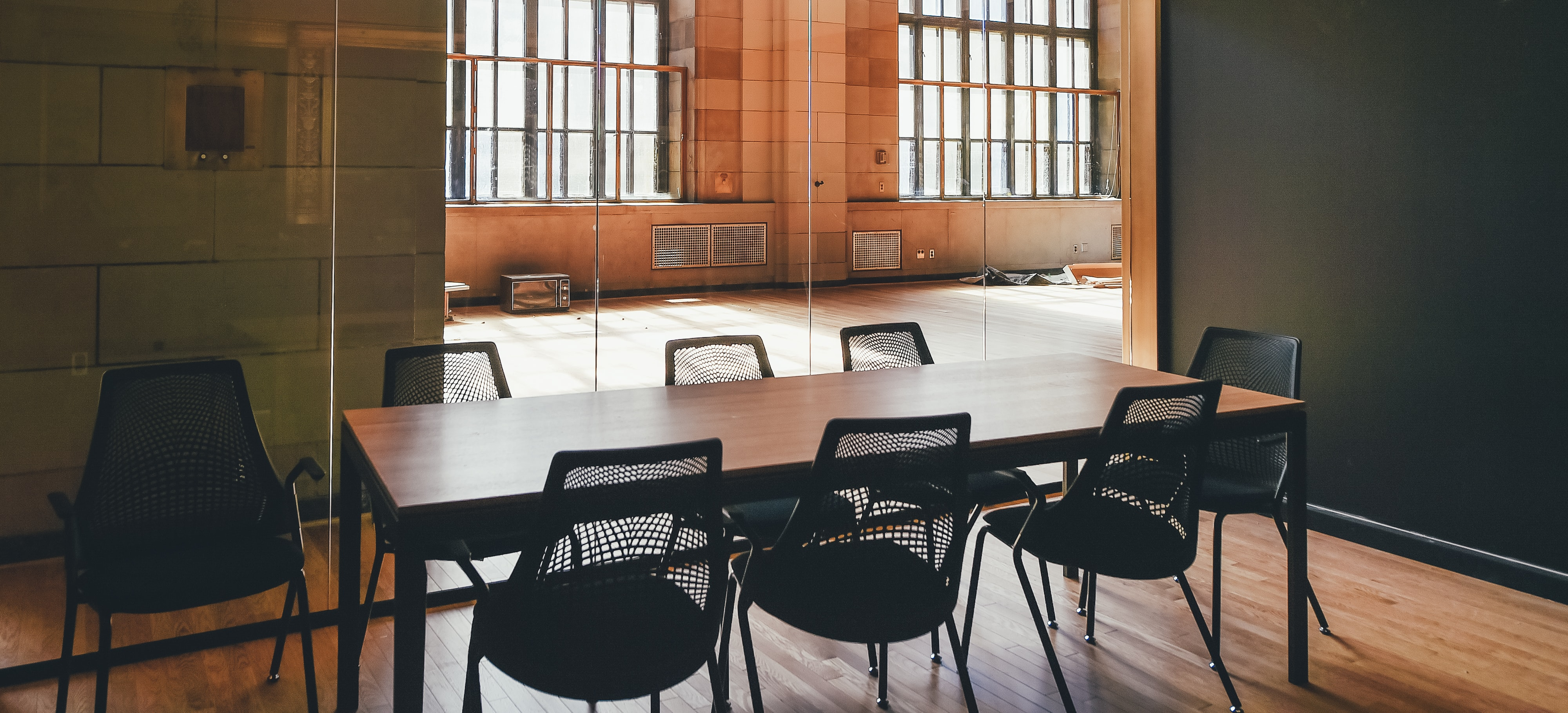 rectangular brown wooden dining table and black steel chairs