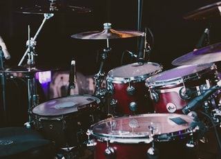 selective focus photography of red drum set