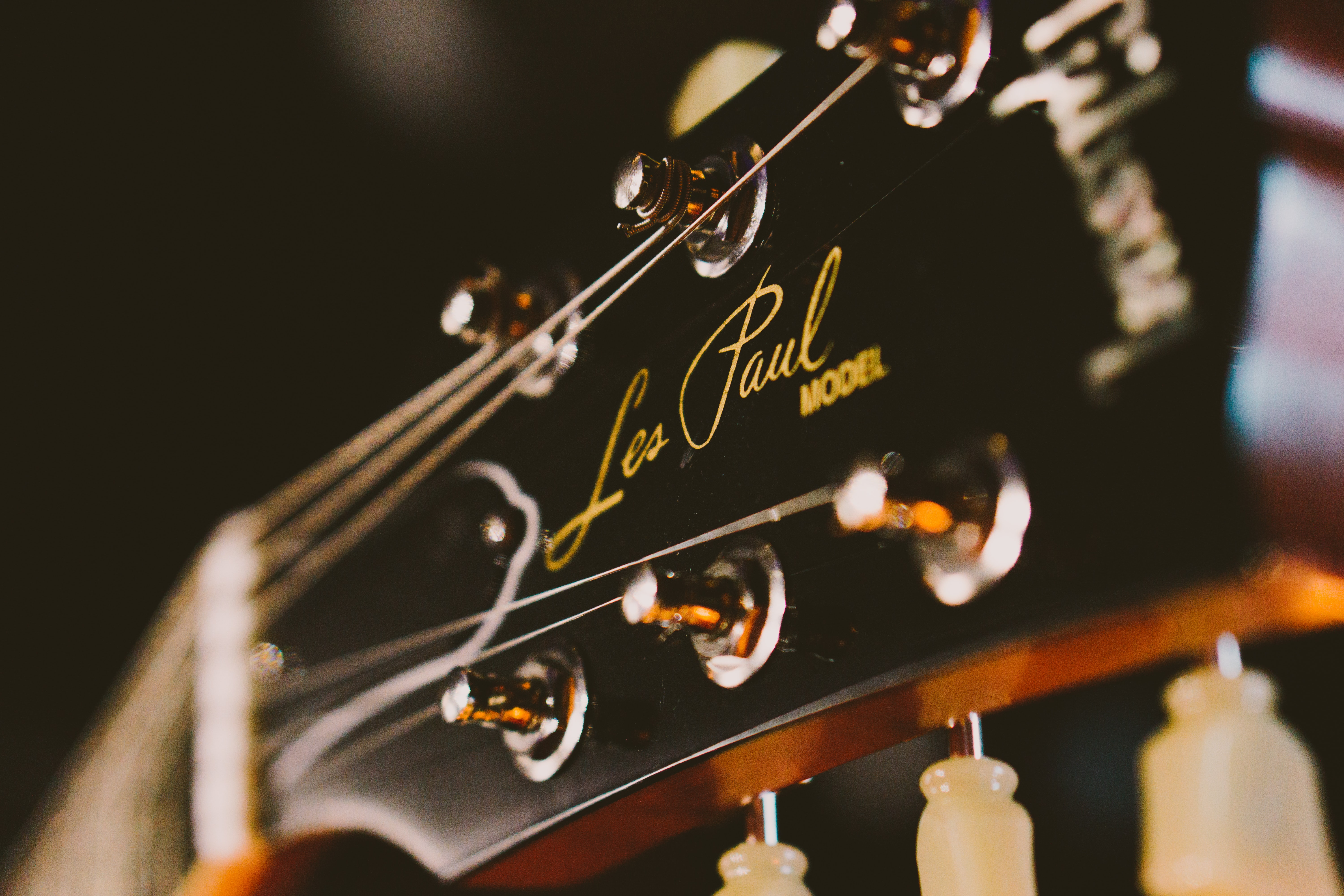 A close-up of the headstock of a Les Paul guitar