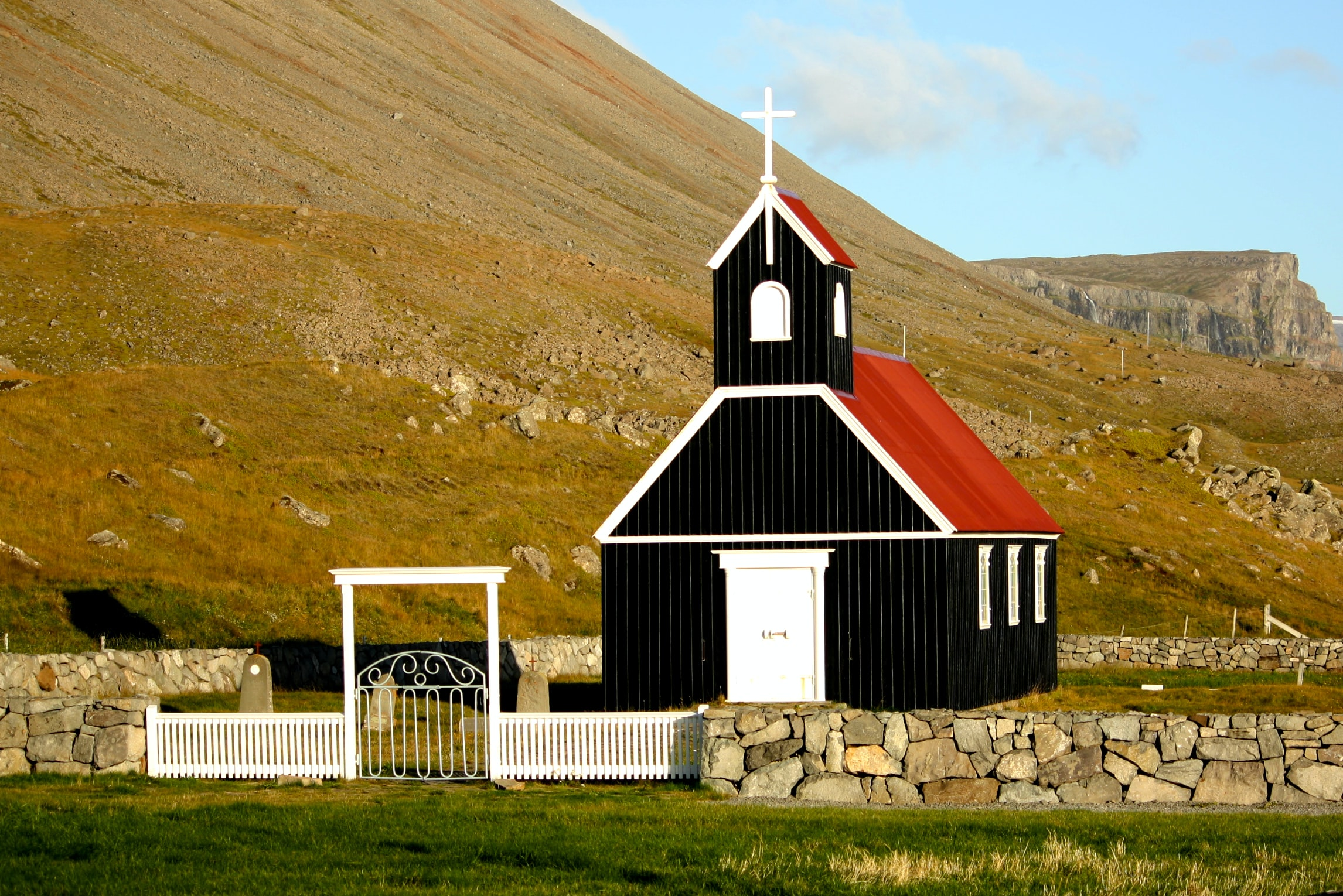 black and red church near mountain ranges