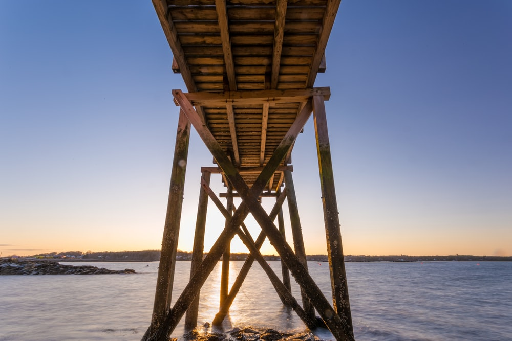 brown wooden dock in low angle shot