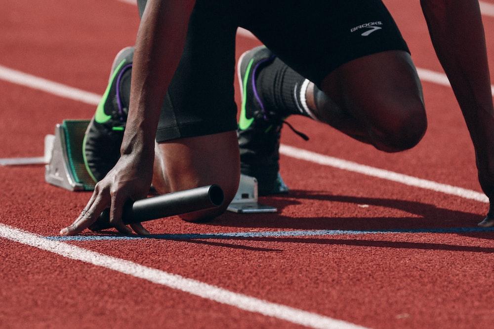 man on running field