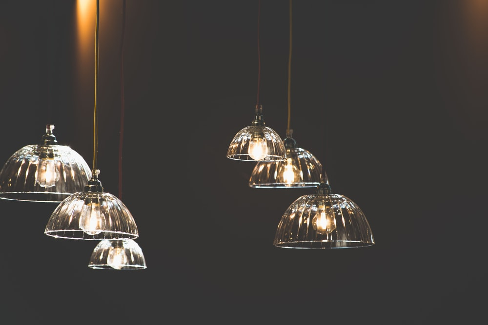 six clear pendant lamps in dark room
