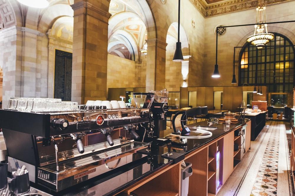 commercial espresso machine on wooden countertop
