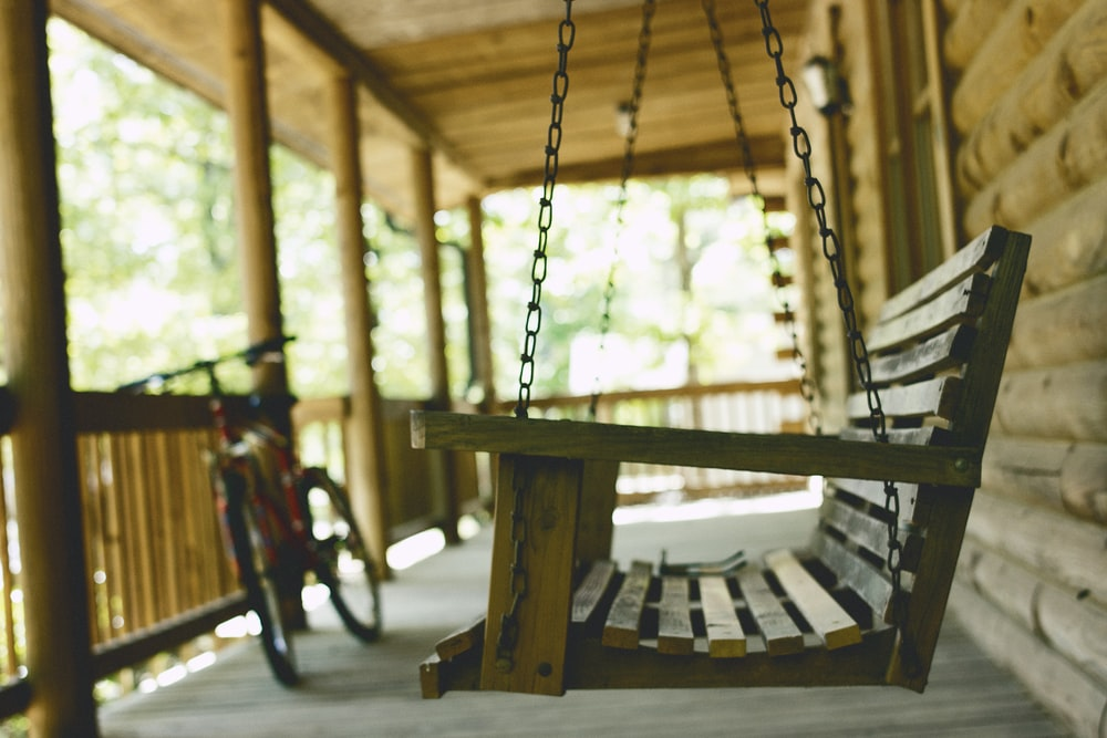 brown wooden swing