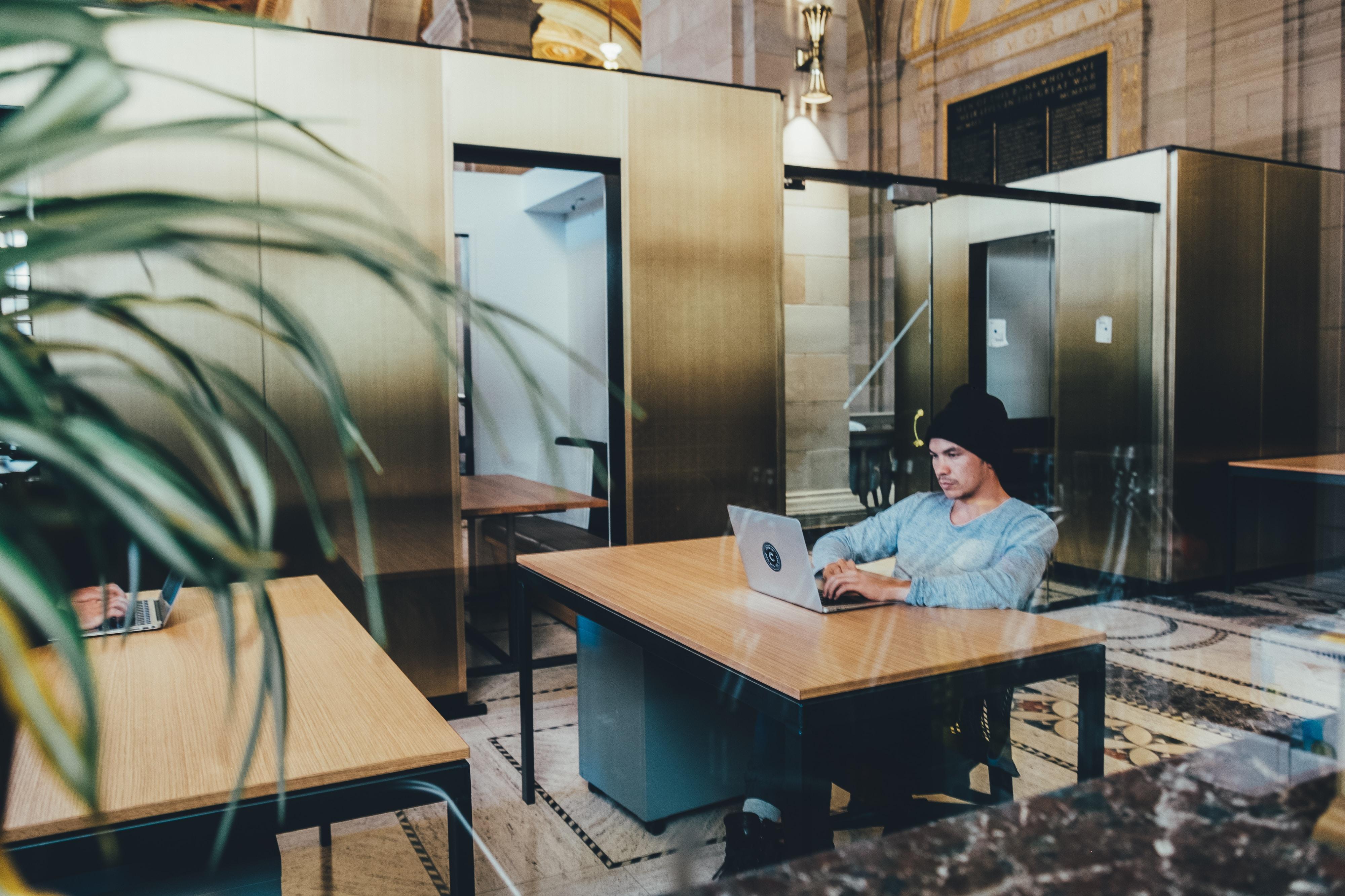 man using a gray laptop computer