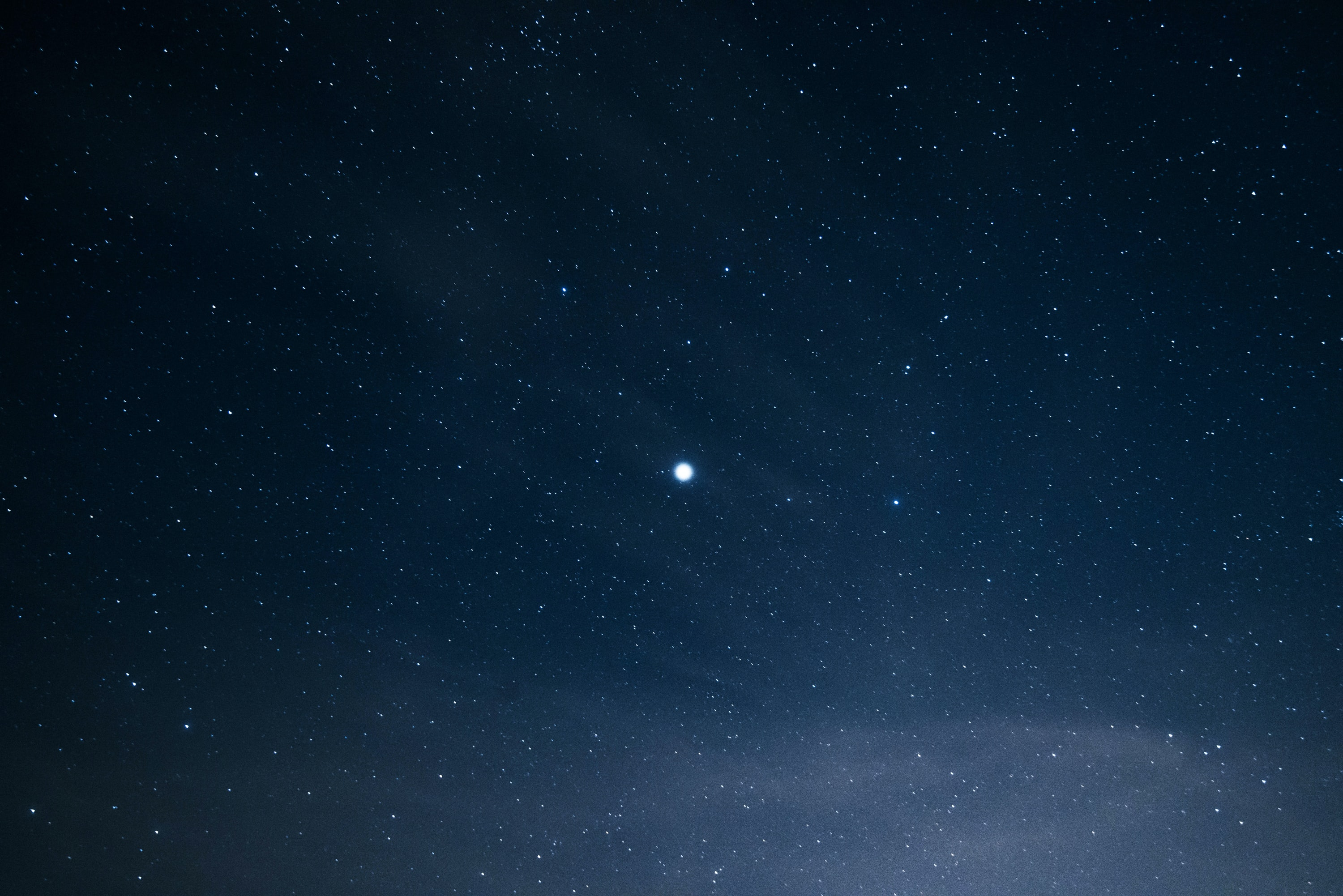 In the night sky full of stars stands a bright lone star