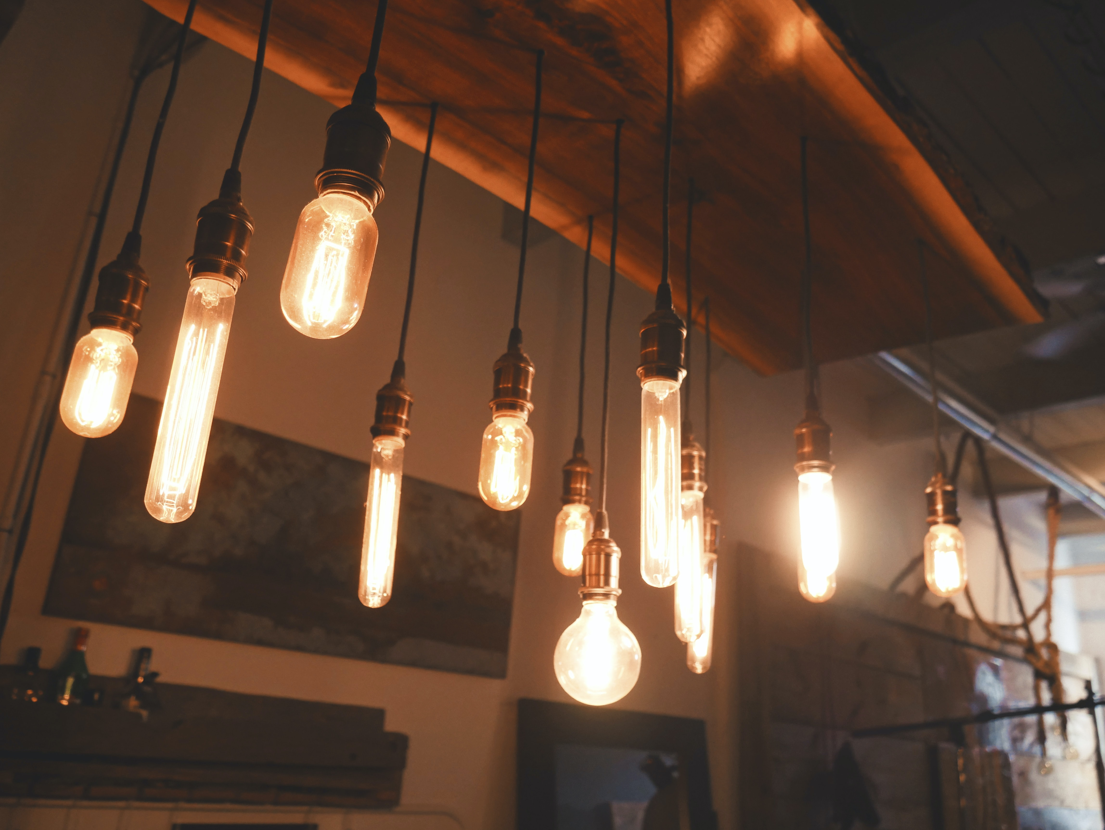 photo of edison light bulbs hang on ceiling