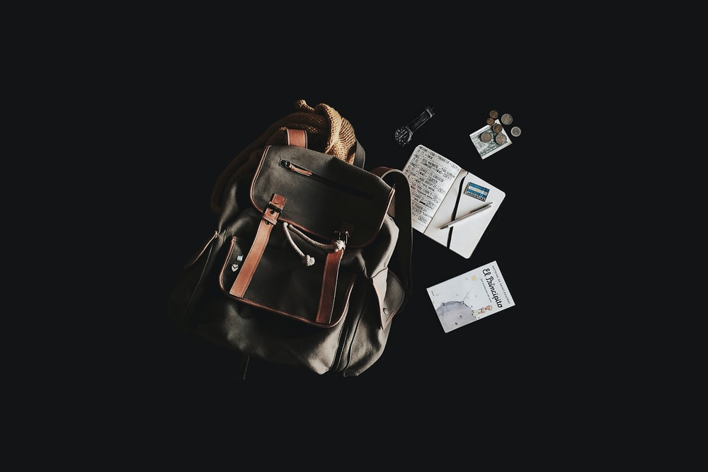 black and brown backpack with black nackground