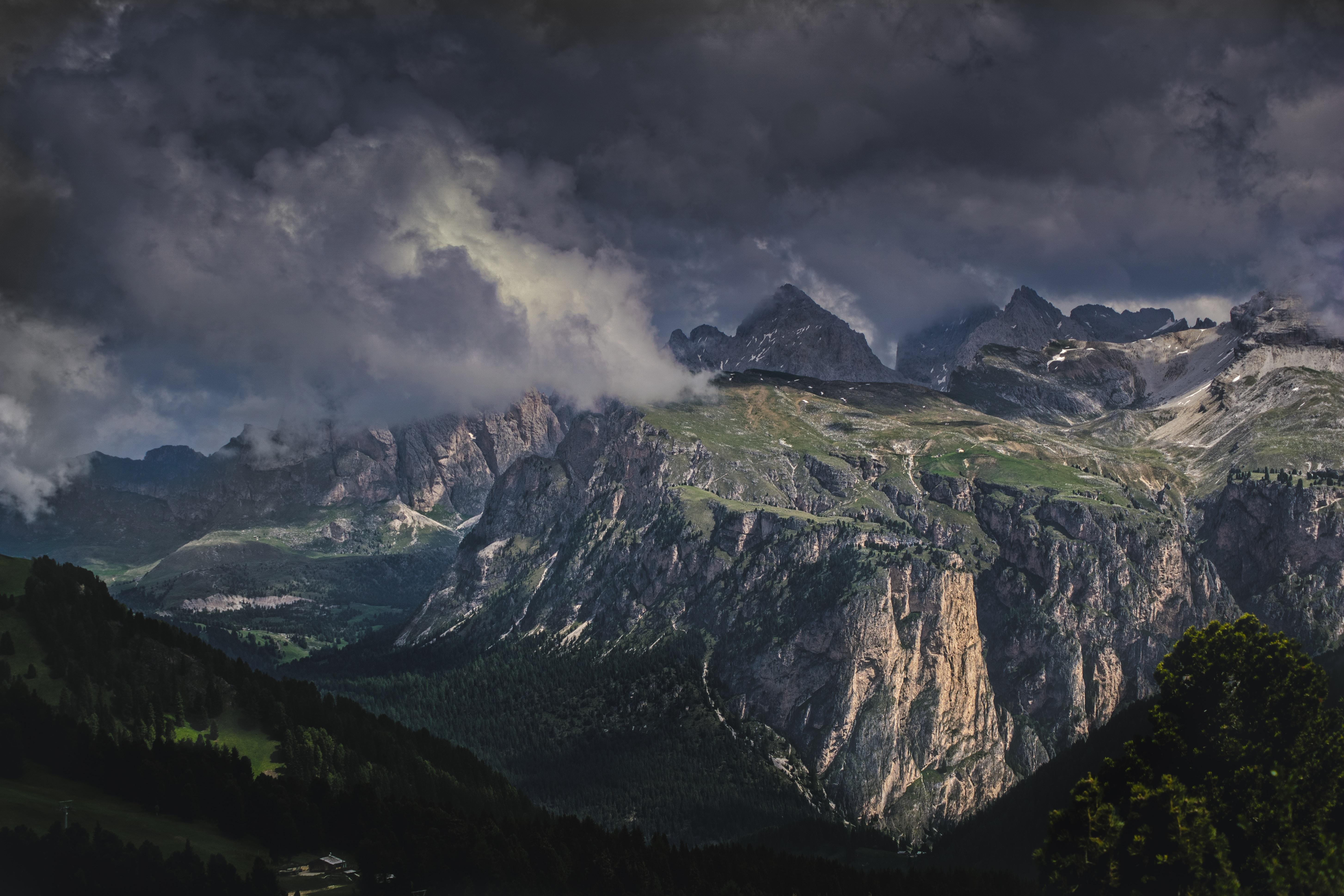 bird's eye view of mountains under nimbus cumulus clouds