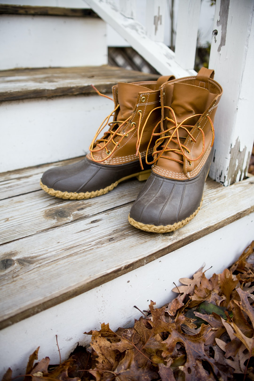 Fall boots on a porch in Autumn