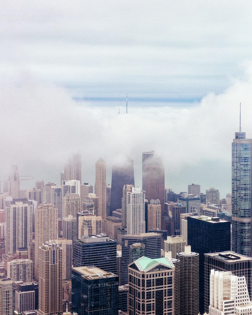 skyscrapers under cloudy sky