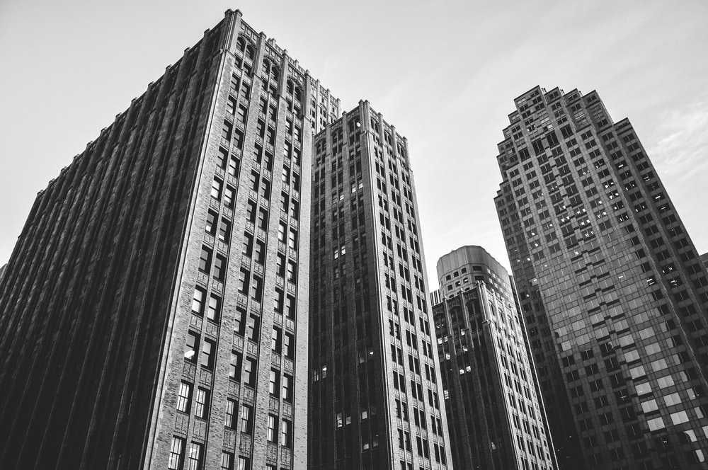 low angle grayscale photography of high-rise buildings