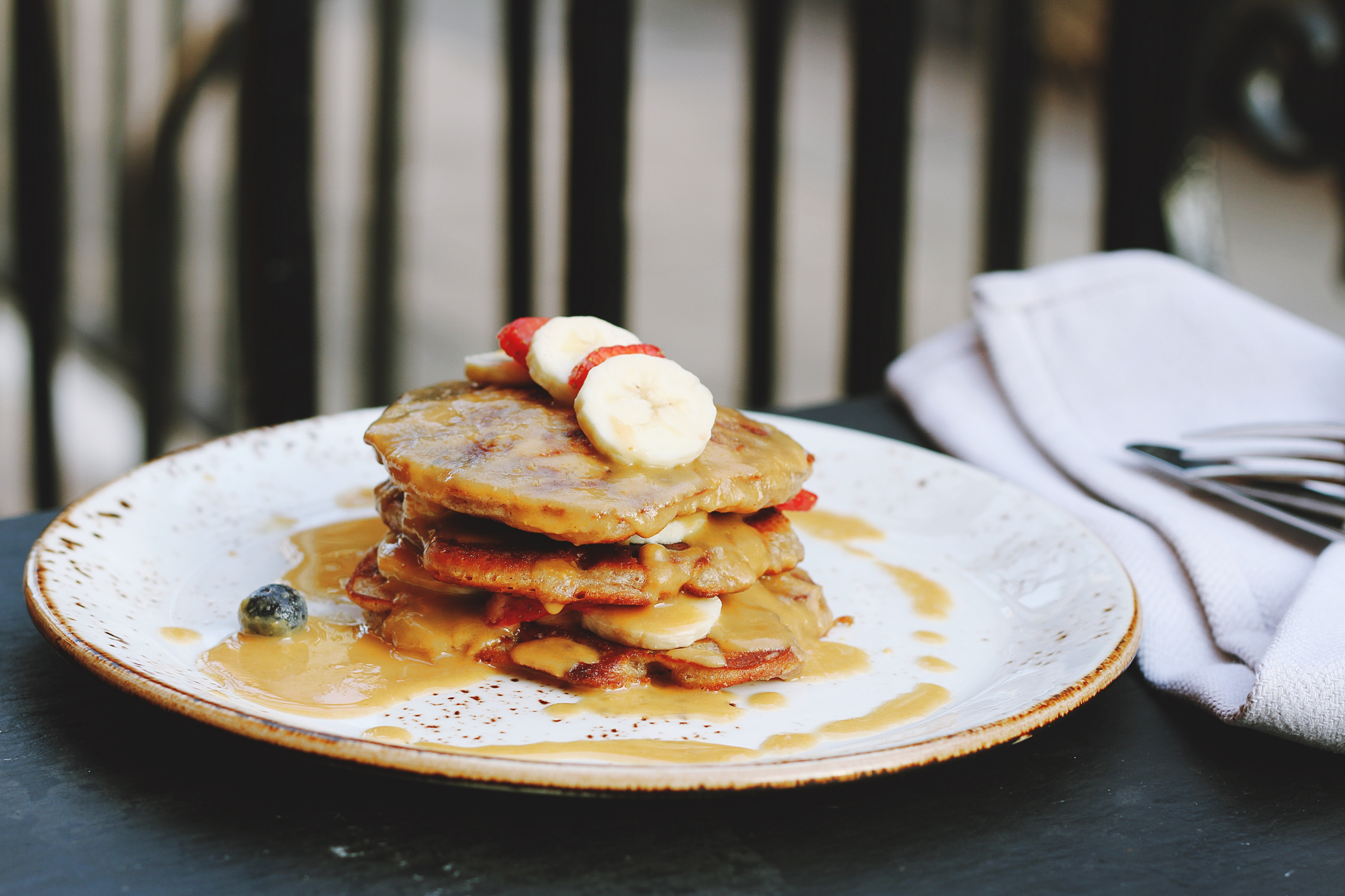Stack of pancakes with berries and syrup
