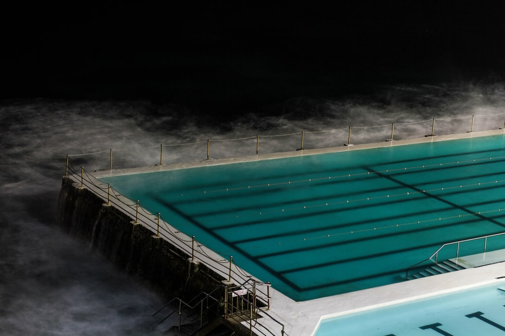 rectangular swimming pool surrounded by mist