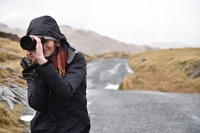 photo of woman taking pictures