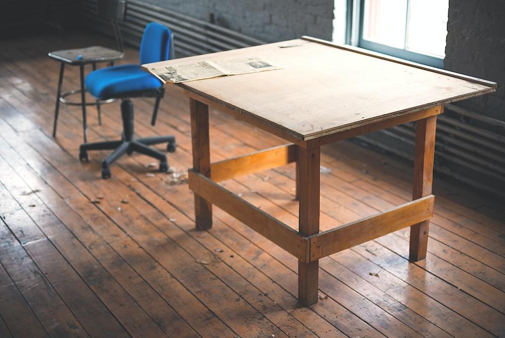 photo of rectangular brown wooden desk