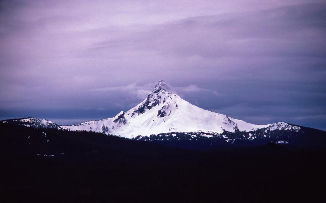 Tall peak under overcast sky