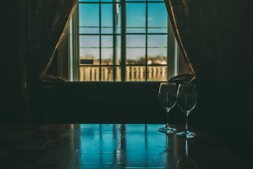clear wine glass on blue table