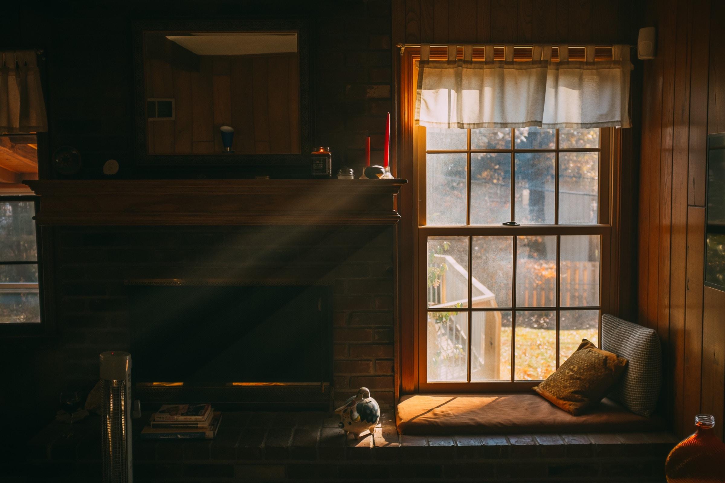 Sun coming through a window into a dark room.