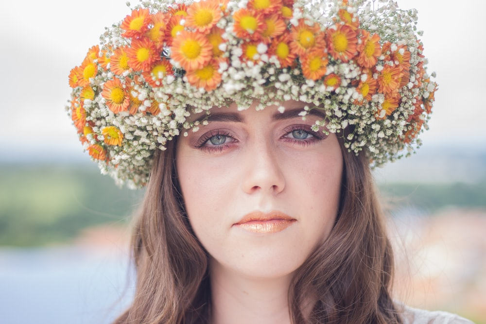 woman with orange and white floral headdress