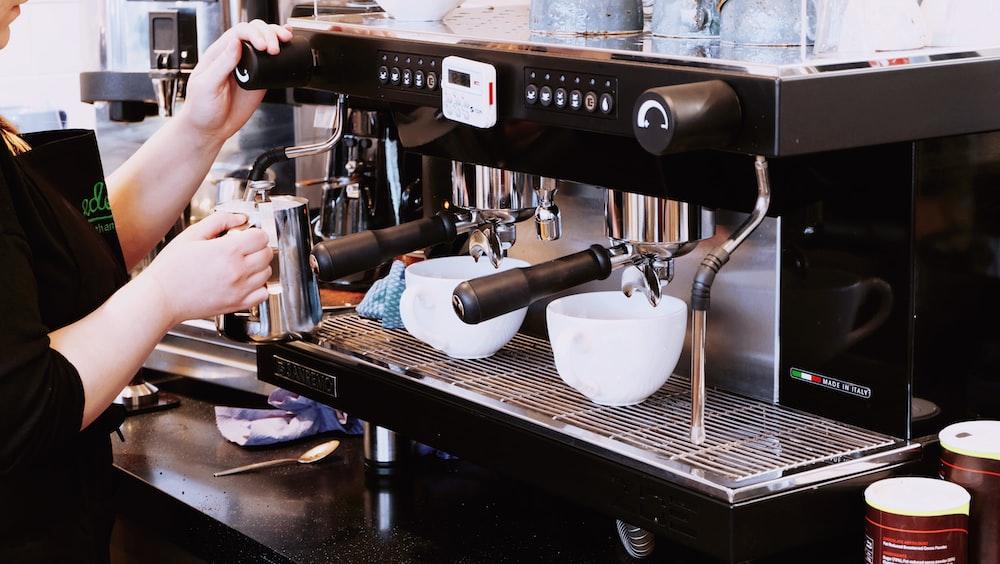 person holding black espresso maker
