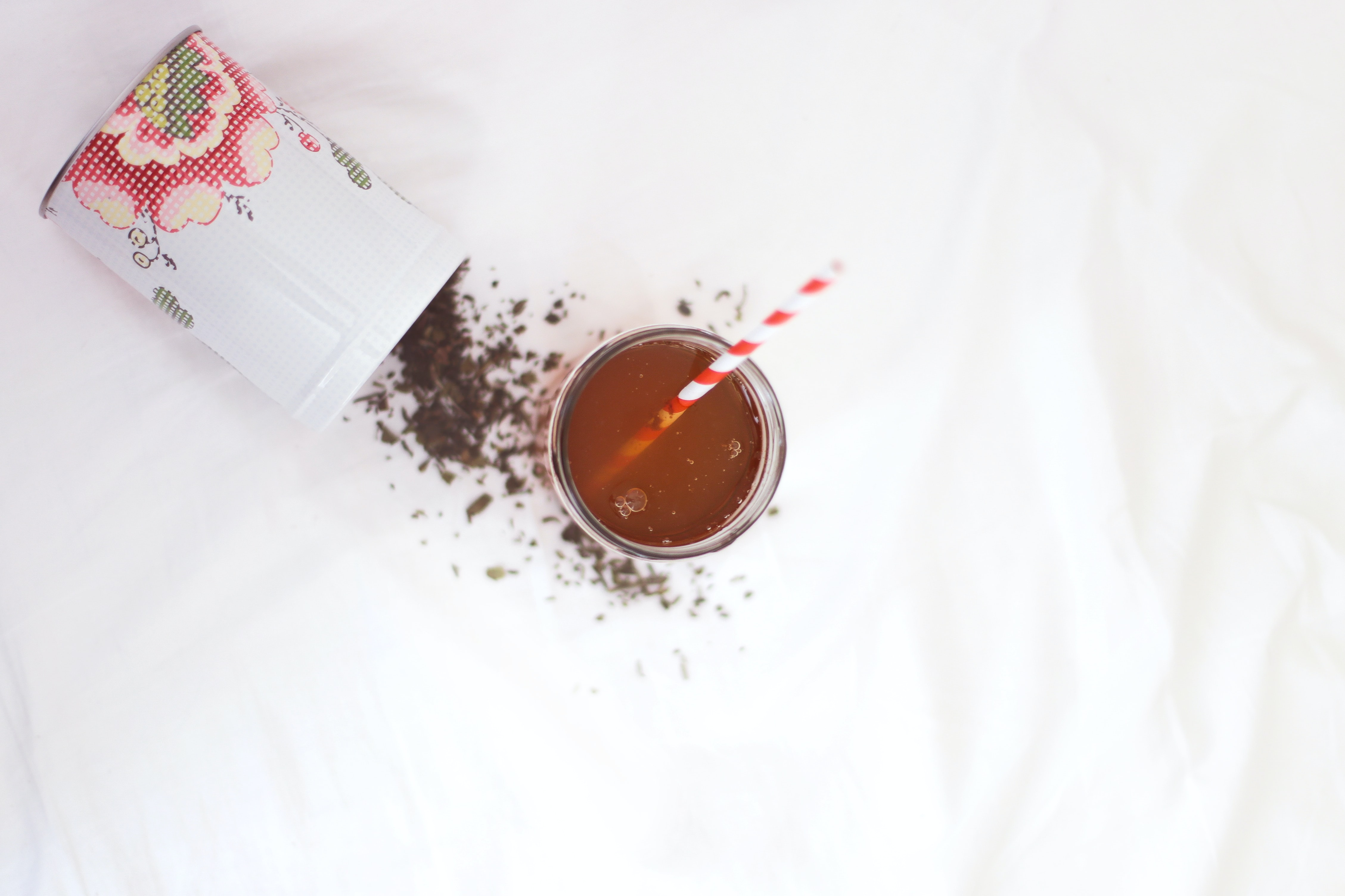 brown liquid with red and white straw