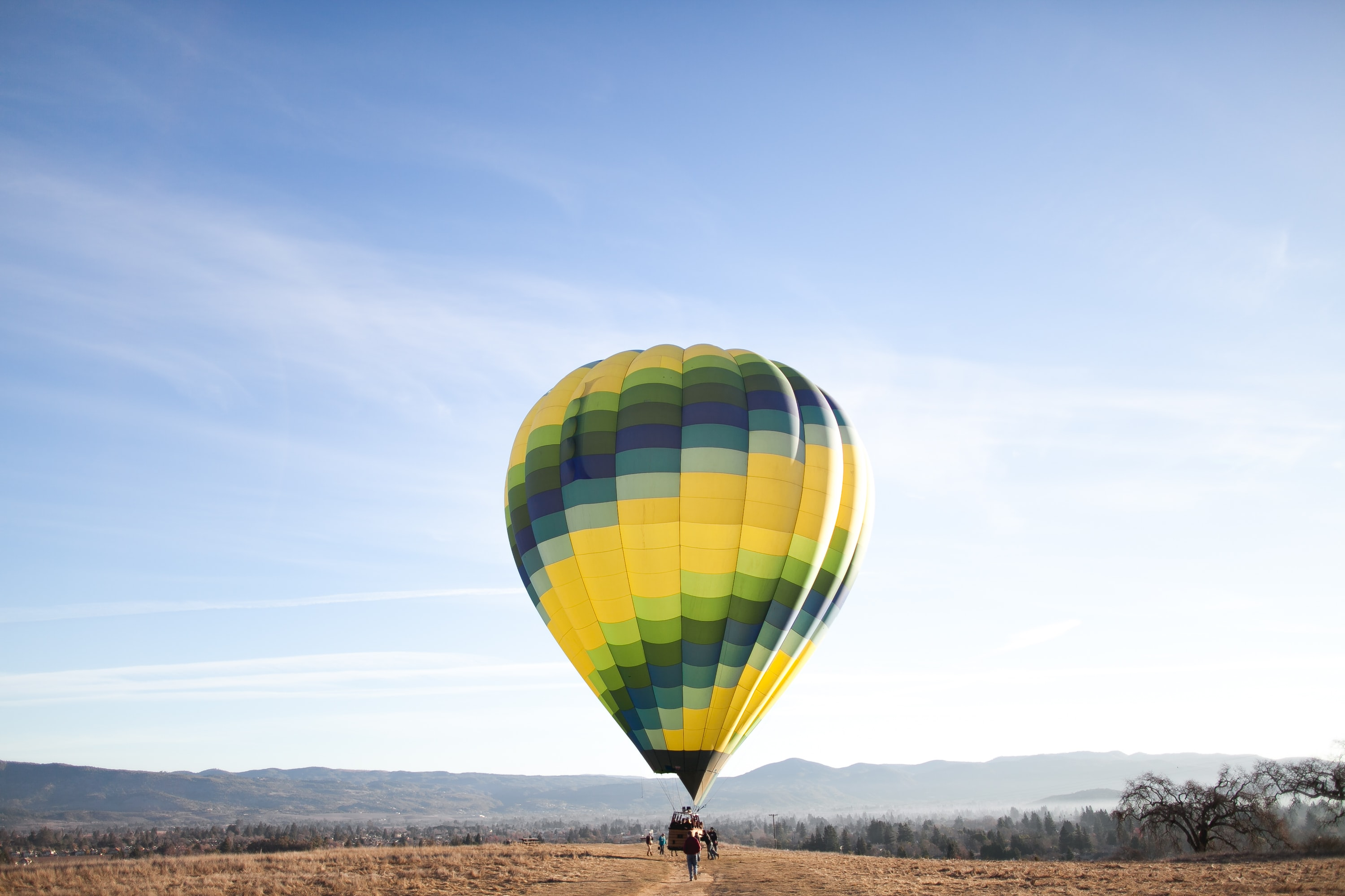 yellow and blue hot air balloon at the ground
