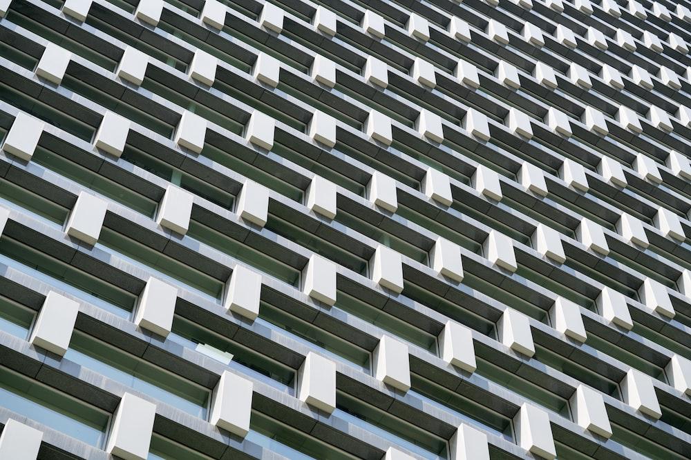 white concrete building balcony wallpaper