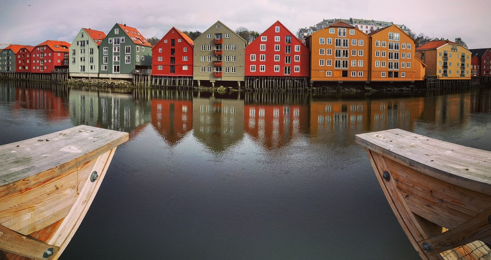photography assorted-color village beside body of water