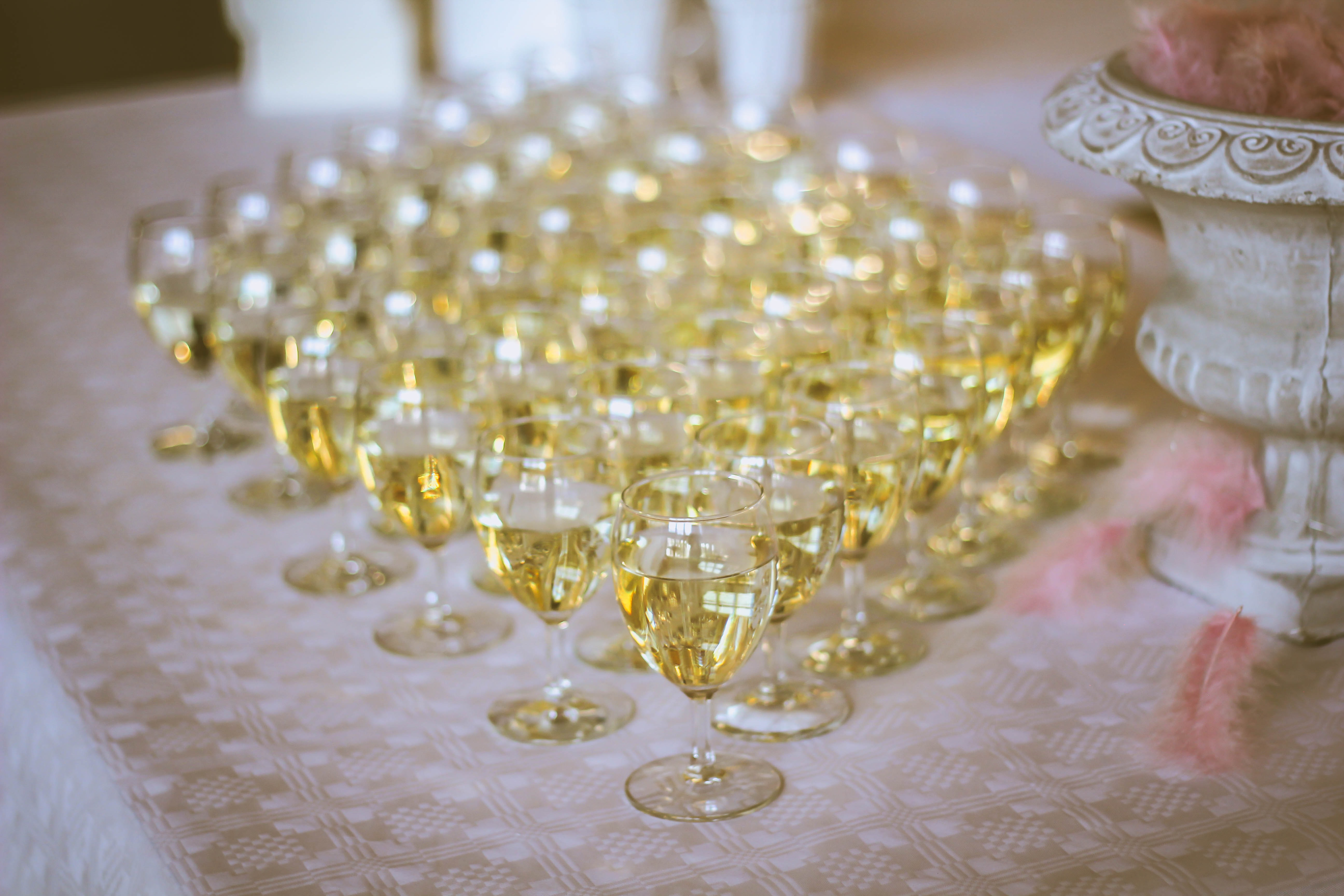 Glasses of champagne on a table.