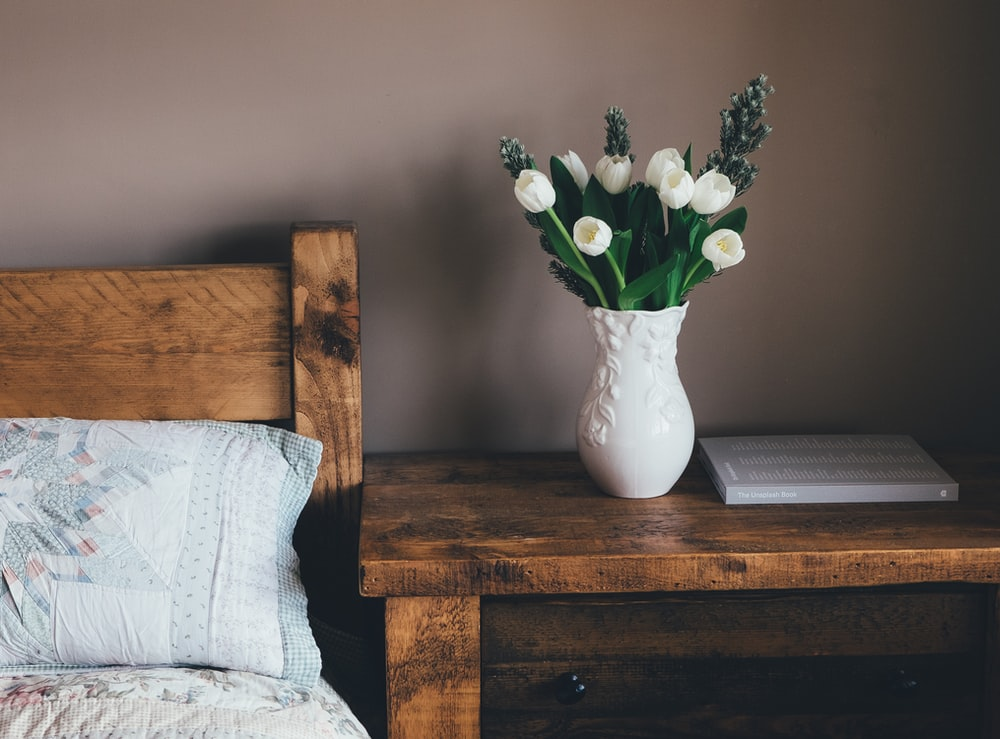 white flower vase on surface