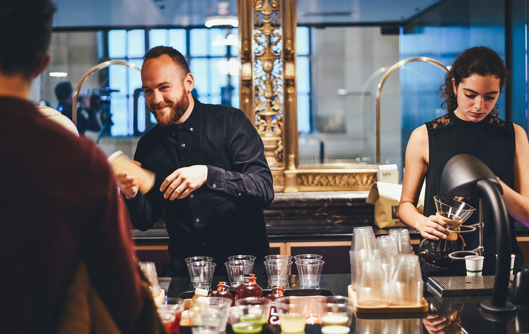 Bartenders serving cocktail