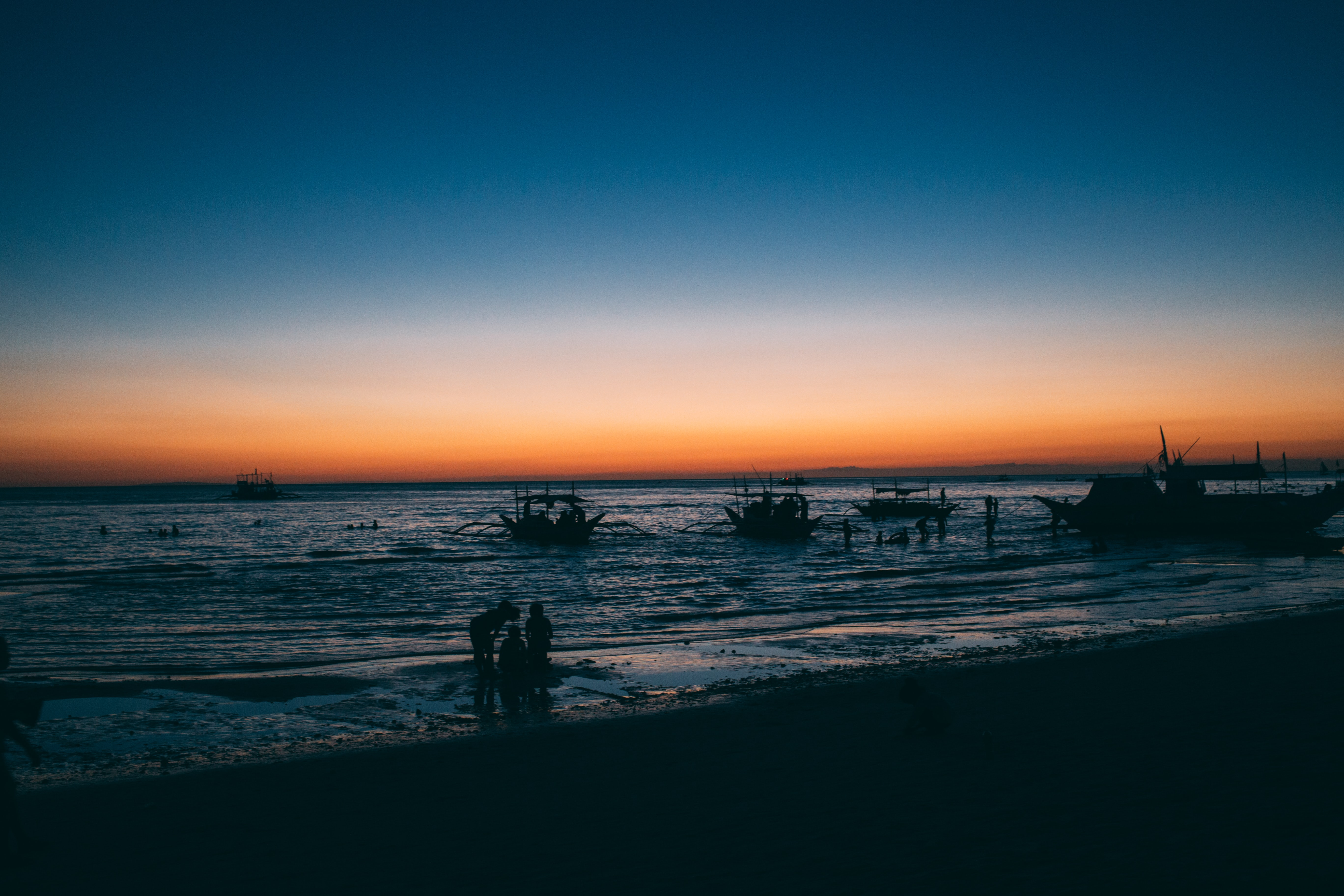 Fishing boats near the coast of Boracay after the sunset