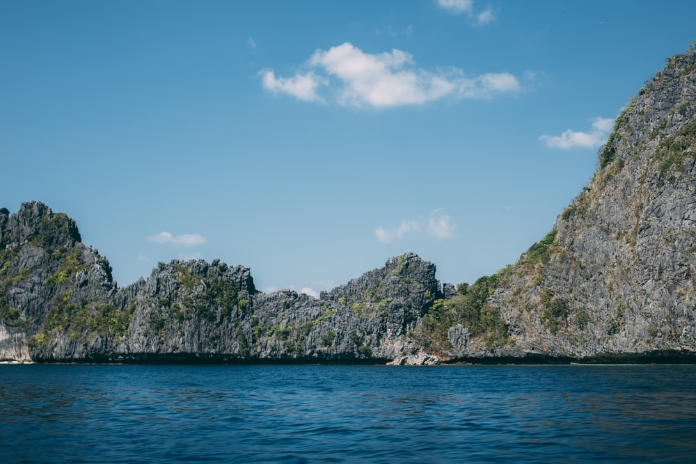 Reynisdrangar Cliff under blue sky during daytime