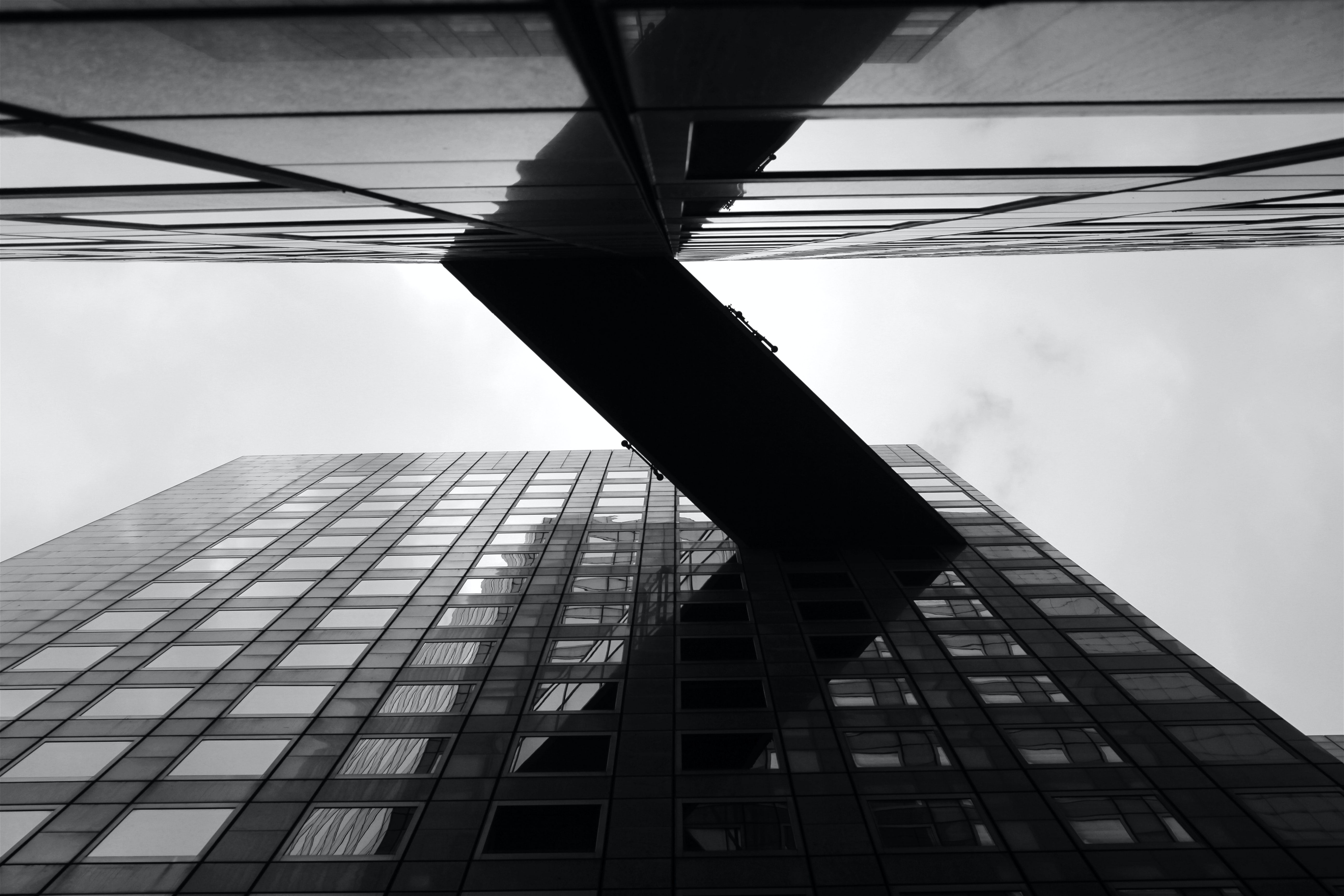 A low-angle shot of a skyway connecting two office buildings