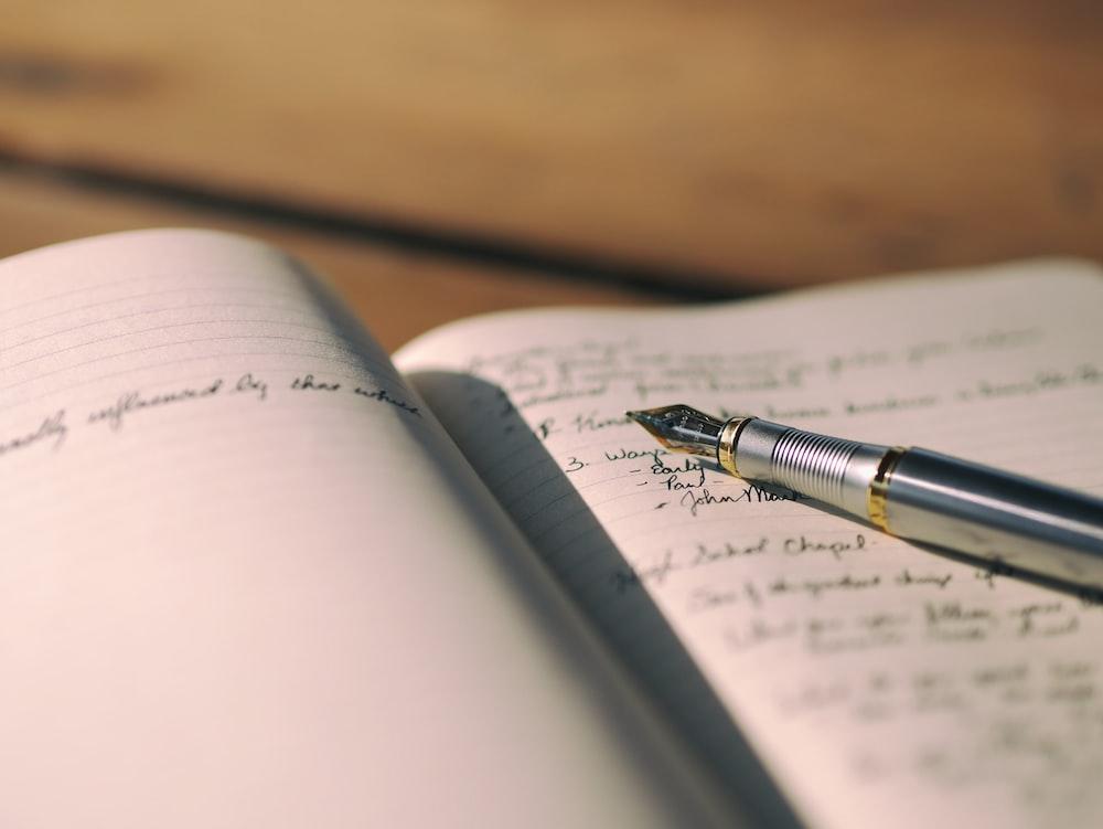 A fountain pen on an open journal